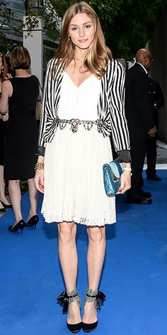 OLIVIA PALERMO The fashionista plays with different textures and prints, layering a lace Topshop skirt, sequined Tibi top, striped Zara blazer, chain belt and blue velvet Christian Dior clutch. As if that weren't enough, she steps into ankle-tie Aquazzura pumps to attend the opening of EXPO1 at the Museum of Modern Art in N.Y.C.