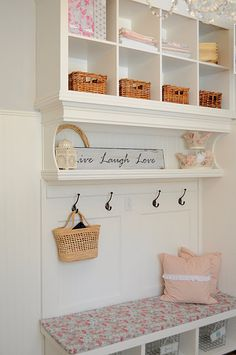 Mudroom bench using IKEA shelves and rolling bench.