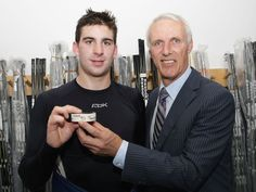 John Tavares scored his first NHL goal on Oct. 3, 2009. Here he is with Mike Bossy and the puck from that historic goal.