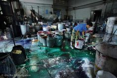 A plant with 5 dyeing machines will need about 250kg of dye, along with other additives. Aproximately 2500kg of dyestuff paste circulates the plant every day. Binhai Industrial Zone. © Qiu Bo / Greenpeace