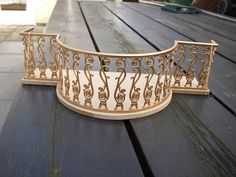 U.K. Miniature site. Sells some unique items, including small stuff. Will do custom work on gates, railings, and balconies.
