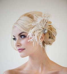 Wedding hairstyle - low braided bun with feathers :: one1lady.com :: #hair #hairs #hairstyle #hairstyles