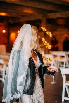 Rock n Roll Bride with a Lace Wedding Dress and Leather Jacket | Veronica Varos Photography on @burghbrides via @aislesociety