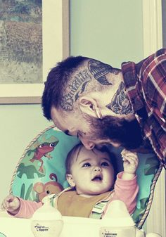 Tattoed parent with baby <3