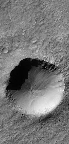 Terra Cimmeria Crater September 7, 2013 This Mars Global Surveyor (MGS) Mars Orbiter Camera (MOC) image shows a crater approximately 2.5 kilometers (1.6 miles) in diameter located in Terra Cimmeria.