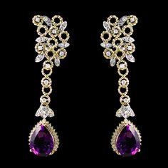 Amethyst Dangling Earrings. Accompanied by Diamonds. Set in Yellow Gold.