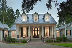 Palmetto Bluff home: Pearce Scott Architects  This is one of our favorite homes at PSA. We love this southern style coastal cottage. What an inviting facade with beautiful windows and shutters, open porch, and tin roof! #homeimprovementarchitects,