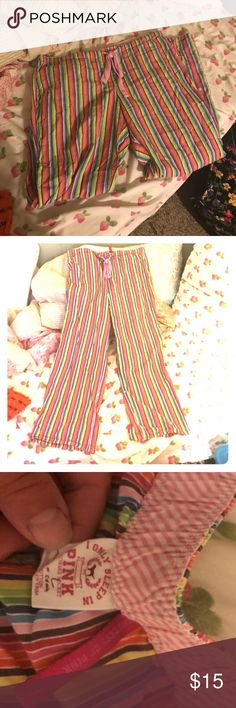 PINK PJ pants PJ pants that are PINK by Victoria's Secret.  Only worn twice so in EUC! Rainbow striped. Size L. Pink colored tie at waist. PINK Victoria's Secret Intimates & Sleepwear Pajamas