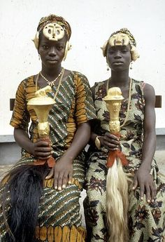 Africa | Katherine Ake Agouabe and Franc̦oise Dao Alouette ( daughters of Ebrie, now Kyaman, notables) with hair ornaments and fly-whisks adorned with gold leaf, Anna village, Ivory Coast | ©Eliot Elisofon.  1972
