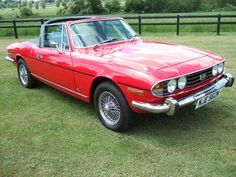 Triumph Stag!!!!!! Love this car. One of the few Triumphs that can fit a family inside. This one is a mark two I think.... Love the colour. Red is always great on a Stag!