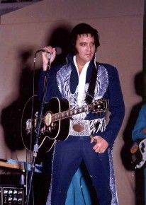 In concert Hulman Civic Centre, Terre Haute, Indiana : July 9, 1975 wearing Silver Phoenix suit