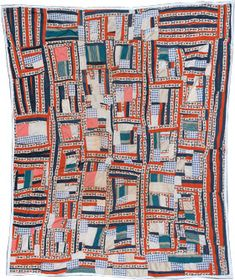 "A quilt from the isolated African-American hamlet of Gee's Bend, Alabama. ""The compositions of these quilts contrast dramatically with the ordered regularity associated with many styles of Euro-American quilt making."" They were noted for their improvisation and simple geometrics."