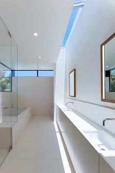 A skylight and clerestory windows light the master bath, which is almost entirely lined in Perla Bianca limestone. Large Bathrooms, Small Bathroom, Master Bathroom, Loft Bathroom, Modern Bathrooms, Skylight Bathroom, Bathroom Windows, Bathroom Cabinets, Bathroom Shelves