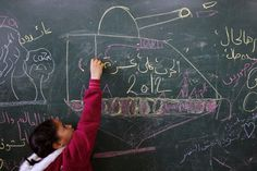 A Palestinian girl writes on a blackboard inside a classroom where displaced families are staying after evacuating their homes earlier this week to take shelter at a United Nations (UN) school in Gaza City. Feminist Issues, Anti Feminist, Feminism Today, Gaza Strip, Take Shelter, Left Wing, A Classroom, Sorting, United Nations