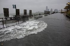 Waves wash over the seawall near high tide at Battery Park in New York, Monday, Oct. 29, 2012, as Hurricane Sandy approaches the East Coast.