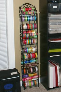 using a wine rack for ribbon storage. Now that is clever. Finally a storage solution for ALL my spools of ribbon in one place!---wow--this is a lot of ribbon lol