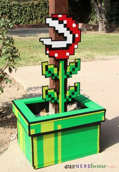 DIY Super Mario 8-Bit Piranha Plant this is hilarious. I shouldn't show Gradie this because he'll make all our planters into mario theme...