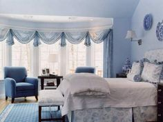 Beautiful Soft swags on bay window in bedroom