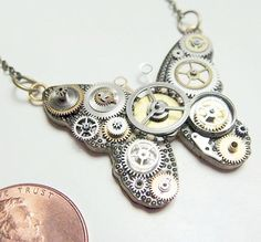 Micro-Mechanical Butterfly Necklace - ecofriendly made from recycled repurposed watch parts.. $45.00, via Etsy.