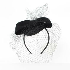 beautiful winter hat with a big bow by Mademoiselle Chapeaux