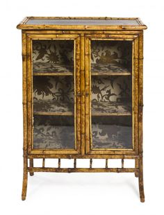 A Victorian Lacquered Bamboo Cabinet, Height 41 1/ : Lot 836