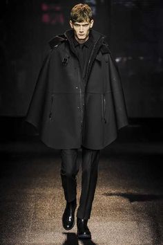 Of course Ferragamo gets this look right!  Hooded, wool, leather lined poncho with slim fit slacks...YES YES YES!!!  Anyone stumped on what to get me for my birthday, here it is.