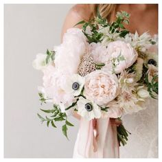 Bouquet obsession! Mixed baby pink and blushing blooms with accents of wild flowers. What a pretty arrangement.