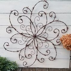 Wouldnt this barbed wire swirl add a bit of elegance to your rustic decor? Made from reclaimed barbed wire, it is undeniably rustic. But the curliques that I carefully twisted and specifically placed step up its character to a bit more refined. Can be displayed indoors or out.