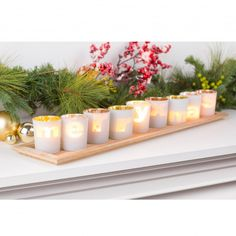 Add a fun and unique display piece to your seasonal decor this winter with our Lettered Candleholder.