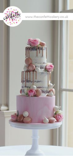 Modern wedding cake with semi-naked tiers and marbled sugar paste. Decorated with rose gold drips, macarons, meringues and roses. Cake & Image: The Confetti Cakery. Venue: Stubton Hall.