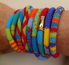 Multicolored bangles by Aussie artist Yvonne Kuriata. Not sure if this is actually one long piece wrapped around or several bangles made to coordinate w/ each other, but it's gorgeous either way.
