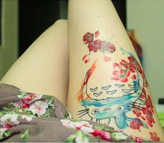 This watercolored Totoro that's dotted with blossoms. | 27 Studio Ghibli Tattoos That'll Make Your Heart Croon