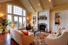 Living room - warm and inviting - beautiful decor - beautiful door and fireplace - love the rug - SW Concord Buff paint   Synergy Staging