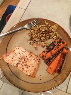 It may not look pretty but it was good! Cedar planked salmon (one red) with sweet potato hash (one yellow) and BBQ carrots (one green) with a balsamic- honey glaze!