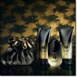 4/piece set Silky seductive oriental laced w/sexy woods and sensual black honey. spray, body lotion, and shower gel, w/jewerly bag.  value $53