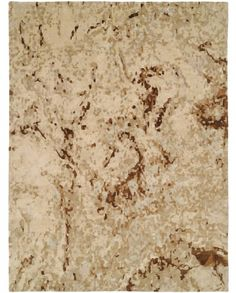 An ivory and brown rug/carpet available through David E. Adler, Inc. Oriental Rugs in Scottsdale, AZ