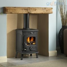 Installing a wooden mantel above a wood-burning stove - Wood Burning Fireplace Inserts Electric Wood Burning Stove, Electric Log Burner, Wood Burning Stove Insert, Wood Burning Fireplace Inserts, Electric Fireplace, Inglenook Fireplace, Fireplace Logs, Fireplace Ideas, Craftsman Fireplace