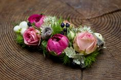 Dress the groom to please with these pink blooms as a buttonhole.