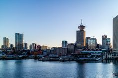 Enjoy the day's last rays of sun in this Vancouver cityscape by Arthur Castro!