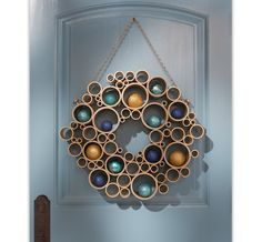 And last but not least, Home Depot shared their Hide-and-Seek Wreath in their Style Guide that takes PVC pipe and turns it into this wreath full of circles to house your ornaments and keepsakes in.