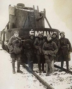 "Artillery wagon of the armored train ""Śmiały"". On the left side Lt. Stanislaw Małagowski (who died on July 25, 1919.). On the right side (in the cap) Lt.. Stanislaw Biega."