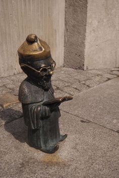 Poland Travel Inspiration - Hunting for Dwarfs in Wroclaw. One of our favourite things to do in Wroclaw was to hunt out the dwarfs / gnomes which are dotted around the old town and further afield. Buy a map at the tourist office or download from the web (