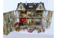 EARLY 20th CENTURY PAINTED WOODEN DOLLHOUSE