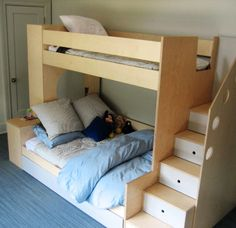 Custom children's Room - Westport, CT    Twin over full size bed.    Includes storage, drawers in the steps and a trundle bed.    Material: Baltic Birch plywood