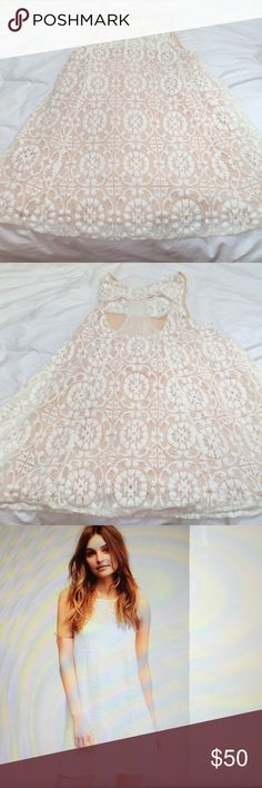 Free people lace mini In a swingy silhouette, this American  made sleeveless mini dress features cut out detailing in back, lined.  The color on the free people is much whiter than in person, more cream/petal pink in person Free People Dresses Mini