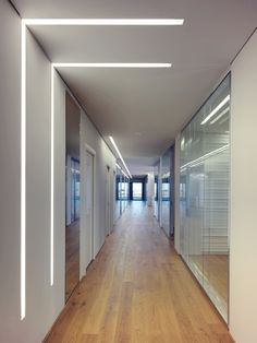 Oficina Vidre Negre by Damilano Studio Architects in Piemonte, Italy. nice use of lighting to connect wall to ceiling