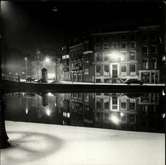 1950's. A winter scene of the river Amstel in Amsterdam. The river Amstel runs through Amsterdam where it flows in the river Het IJ. The river originally began where two smaller rivers, the Drecht and Kromme Mijdrecht, joined together, south of the town of Uithoorn. After the construction of a canal, the Amstel-Drecht Kanaal, the Amstel now begins where the Drecht and another canal, the Aarkanaal, meet one another, near the town of Nieuwveen. PhotoCas Oorthuys. #amsterdam #1950 #amstel