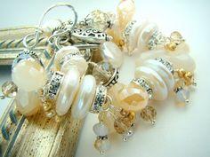 Crystal charm bracelet, chunky pearl bracelet, pale topaz... Milk and Honey by strandsofgrace on Etsy https://www.etsy.com/listing/155941649/crystal-charm-bracelet-chunky-pearl