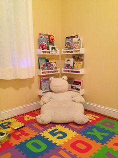 Reading nook in Ella's playroom. Ikea spice racks.