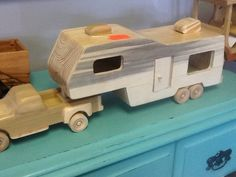 This pickup truck and fifth wheel trailer has been by GiantElfToys I want this!!!!!!!! This looks exactly like our old camper and truck!  Don't want the yucky black tainted wood tho. :(. Omg!! Really love!  Now,, ? Do I order or ask dad to make actual replica of ours? ?